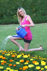 Beautiful Girl Watering Flowers