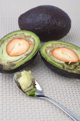 avocadoes with spoon