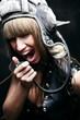 Young attractive girl in tank helmet