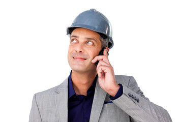 Charming male architect on phone looking up