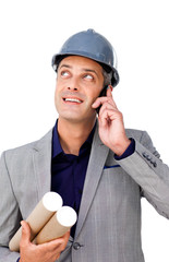 Smiling male architect on phone looking up