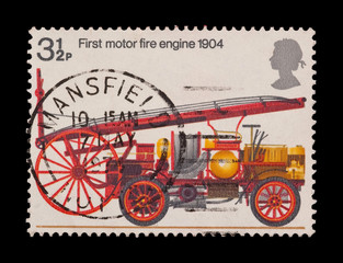 mail stamp featuring the first motor fire engine