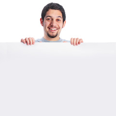 Smiling young man behind large poster board sign