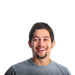 Young man with goatee smiling & laughing head portrait