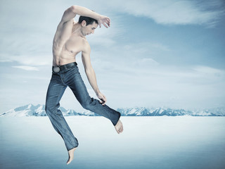 Taekwondo fighter training , over winter background