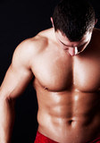 Athlete showing his abdominal muscles poster