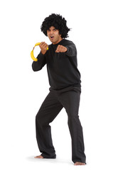 Ethnic Afro-Ninja karate man spoof with banana nunchucks