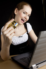 businesswoman with a notebook and payment card