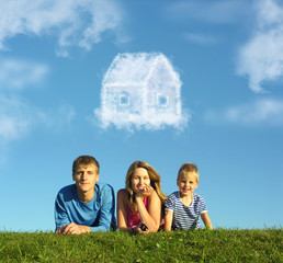 family with boy on grass and dream cloud house collage