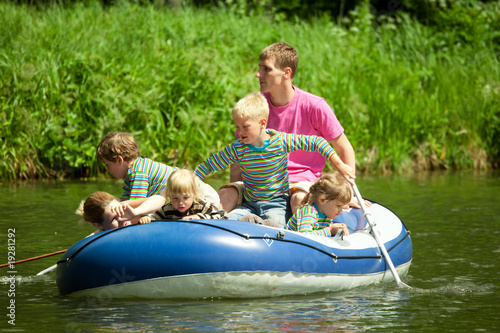 Children go for a drive on an inflatable boat under supervision
