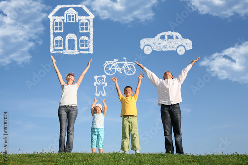 Poster family of four on grass with hands up and dream, collage