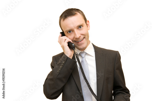 Man handing a black telephone