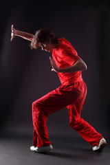 cool modern dancer against black background