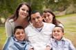 Leinwanddruck Bild - Happy Hispanic Family In the Park