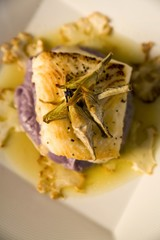 Sea bass on a bed of purple potato puree