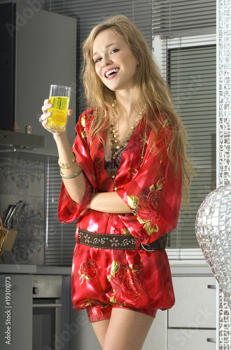 blonde in modern kitchen with juice