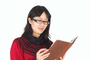 Young woman reads book.