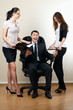 young businessman sit in armchair with collegues