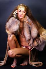 Sexual model in a fur coat