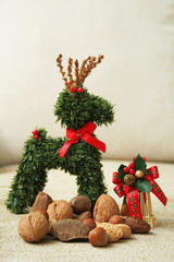 Assorted nuts with Christmas reindeer and bell ornaments