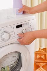 Washing machine and hands.