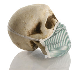 human skull wearing hospital mask - disease concept