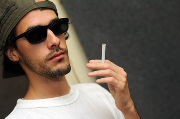 Guy holding cigarette
