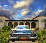 Old car parked in tropical house, cuba