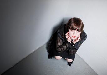 Goth girl in a corner