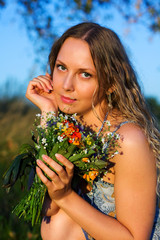 Beautiful woman with a flowers.