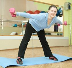 Sporty  girl in blue exercising