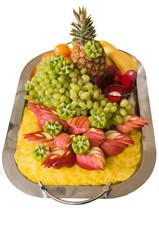 Dish of beautifully cut fruit.