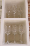 Wine glasses in a cupboard poster