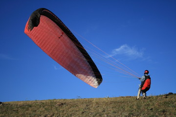 man and a paraglider