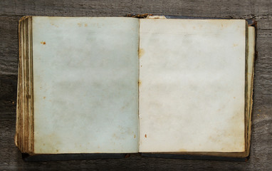 vintage book on old wooden background