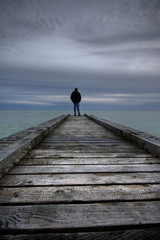 Lonely man on a wharf