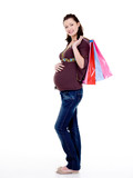 beautiful cheerful pregnant woman with shopping bags
