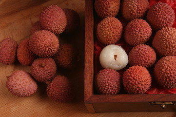 Lychee fruits in antique-style display