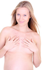 undressed pregnant female holding her breasts