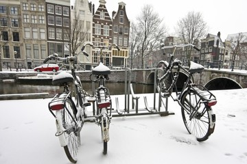 Snowy bikes in Amsterdam citycenter the Netherlands
