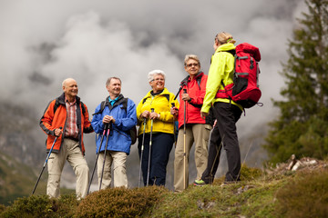 female hiking guide with happy seniors