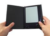 eBook reader in hands poster