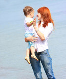 happy mother and son on sea background