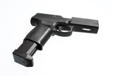 A semi-automatic pistol with an extended magazine