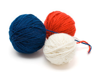 Three coil of yarn in red, blue and white