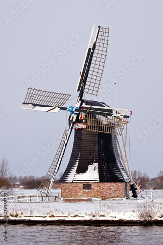 Old dutch windmill in a winter landscape