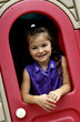 Little girl in playhouse