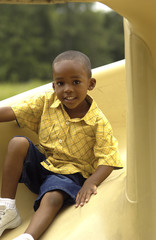 African American boy on slide