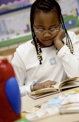 Child reading in class