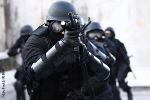 SWAT officers in full tactical gear.